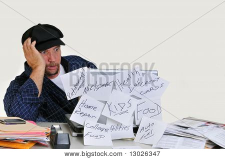 Overwhelmed man dealing with finances
