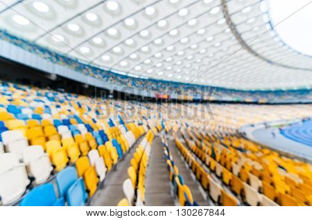 Blurred empty football stadium with stands. 2016 sport background.