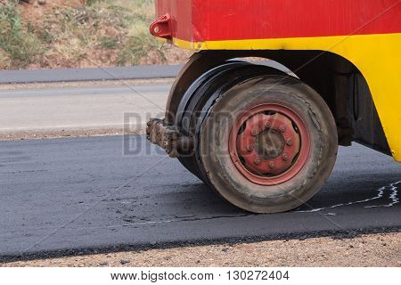 Pneumatic tyred roller compactor at asphalt road repairing