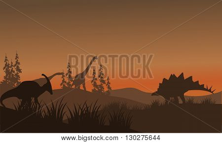 Silhouette oof many dinosaur in hills. brachiosaurus, parasaurolophus and ankylosaurus