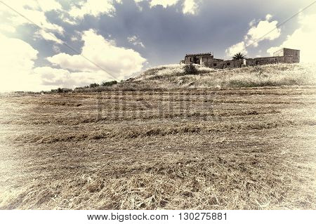Mown Field on the Hill in Sicily Retro Image Filtered Style
