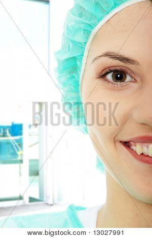 Portrait of female surgeon or nurse wearing protective uniform