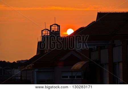 Sunrise over the top of a building roof in Belgrade, Serbia