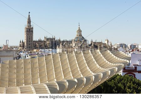Seville Cathedral and Church of Annunciation with Metropol Parasol structure in foreground