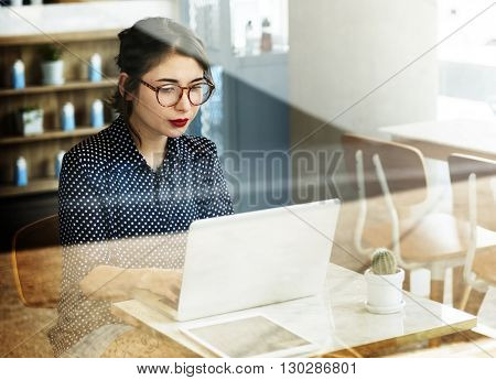 Woman Using Laptop Working Browsing Concept