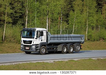 SALO, FINLAND - MAY 13, 2016: White MAN TGS 35.480 tipper truck moves along freeway in South of Finland. The TGS is configured for heavy duty transport.