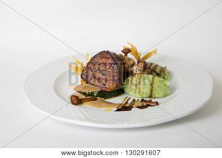 Mignon meat steak served with mushroom garnish
