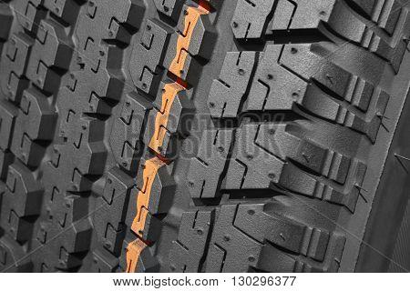 Brand new all terrain tyre macro detail. Vehicle wheel. Horizontal