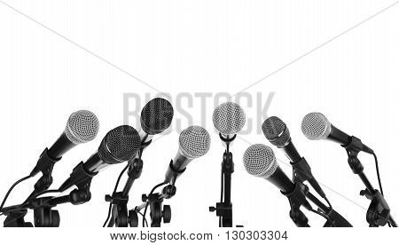 Several microphones prepared for press conference isolated on white