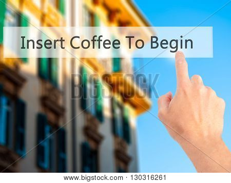 Insert Coffee To Begin - Hand Pressing A Button On Blurred Background Concept On Visual Screen.