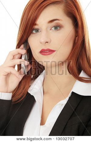 Businesswoman speaking on the phone. Isolated on the white background