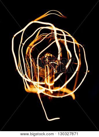 Close up looping carbon filament of vintage Edison light bulb.
