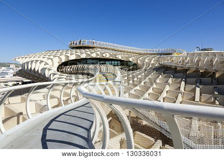 Seville, Spain, - May 1, 2016: Tourists on the upper platform of Metropol Parasol, a wooden structure located at La Encarnacion square in the old quarter of Seville, Spain.
