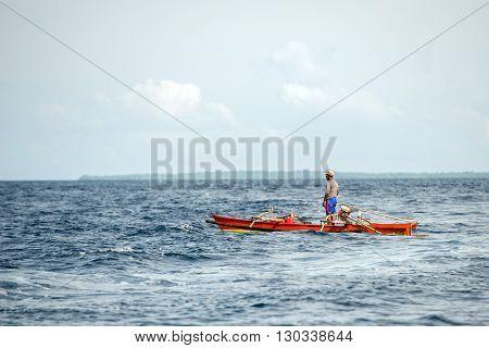 Bunaken, Indonesia - April, 5 2014 - Fishing Boat Returning To Fisherman Village