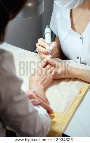 A professional technician grinding machine, nail polish, professional nail care hand