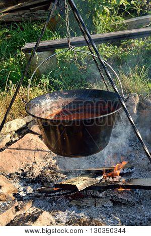 In saucepan campfire cooked Chili con carne