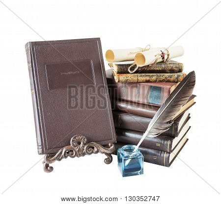 Old books feather pen in inkpot bookrest and scrolls with stamp isolated on white background
