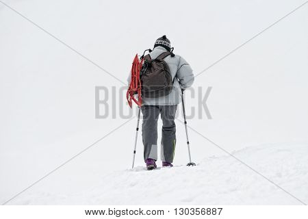 Isolated Snow Shoe Trekker Walking On The Snow