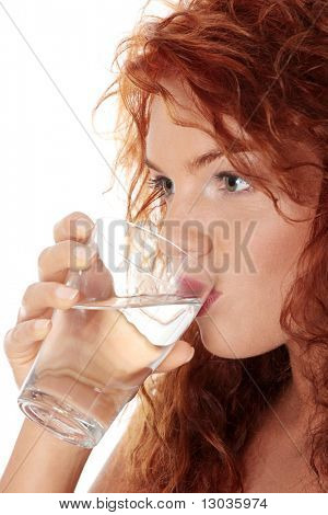 Young caucasian woman drinking water from glass, isolated on white