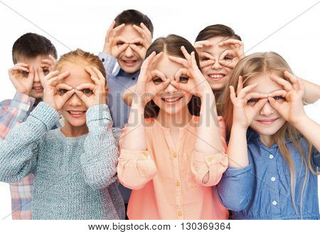childhood, fashion, friendship and people concept - happy children making faces and having fun