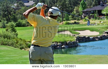 Close-Up Of A Golfer Hitting Over Water