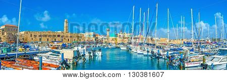 ACRE ISRAEL - FEBRUARY 20 2016: The scenic marina of Akko with white sailing yachts and Sinan Basha Sea Mosque on the background on February 20 in Acre.