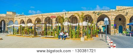 ACRE ISRAEL - FEBRUARY 20 2016: The old Akko offers various cafes and restaurants to taste the local cuisine the Khan e-Shu'arda medieval complex is one of the best choices on February 20 in Acre.