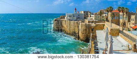 The Acre cityscape with the St John's church surrounded by sea walls and old residential neighborhood Israel.