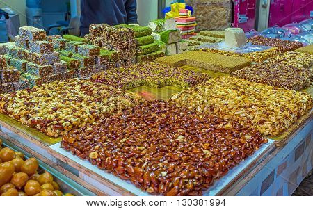 The dessert stall offers gozinaki halva lokum and other traditional sweets Turkish bazaar Akko Israel.