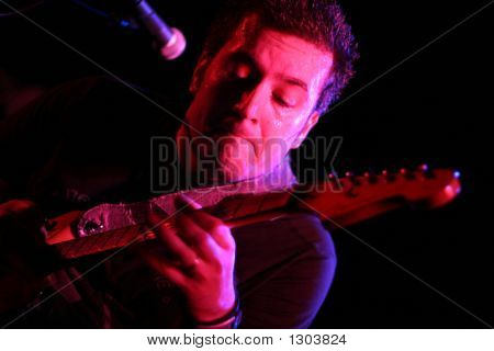 Band Member Playing Guitar Solo On Stage, Close-Up
