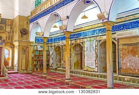 ACRE ISRAEL - FEBRUARY 20 2016: The arches in Al-Jazzar mosque with old arabic calligraphy surround the prayer hall on February 20 in Acre.