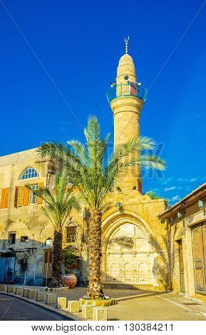 The stone minaret and ablution fountain of Mahmoudiya Mosque that is the largest and most significant mosque in Jaffa Tel Aviv Israel. poster