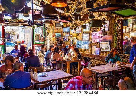TEL AVIV ISRAEL - FEBRUARY 25 2016: The crowded cafe in old Jaffa offers the best shakshuka in city on February 25 in Tel Aviv.
