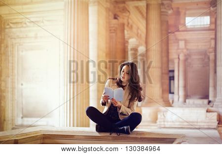 Classy woman reading a book