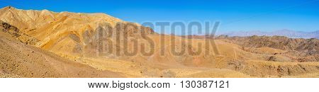 The desert Eilat mountains are popular tourist place with the scenic landscape and unusual color Israel.