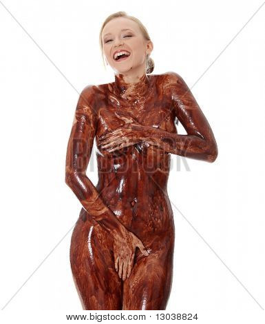 Young beautiful woman with her naked body covered of sweet cream chocolate, isolated on white