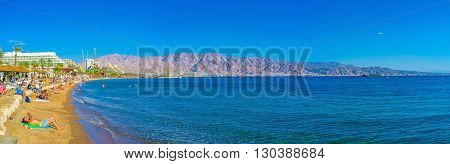 EILAT ISRAEL - FEBRUARY 23 2016: The view on beaches of Eilat and mountains of Jordan on February 23 in Eilat.