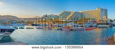 EILAT ISRAEL - FEBRUARY 23 2016: Panorama of Lagoona in bright sunset beams with many colorful pleasure boats on February 23 in Eilat.