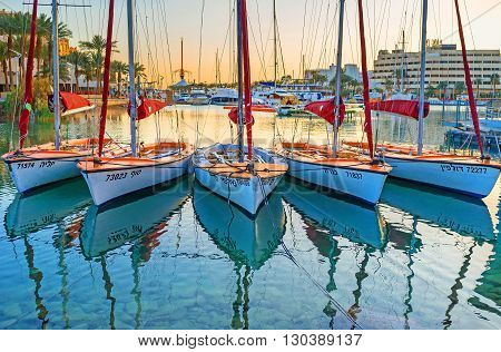 EILAT ISRAEL - FEBRUARY 23 2016: The yacht sport is very popular in Eilat so in the evening there are a lot of yachts in harbor on February 23 in Eilat.