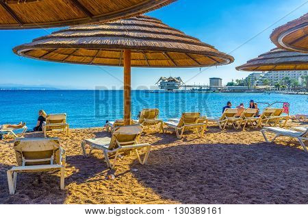 EILAT ISRAEL - FEBRUARY 23 2016: Winters in Eilat are very mild and comfortable for relaxing on the beach on February 23 in Eilat.