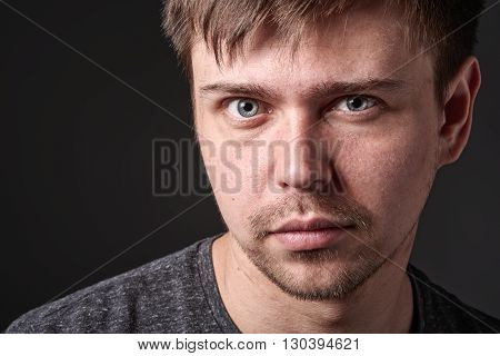 Close Portrait Of Casual Young Man With Light Beard