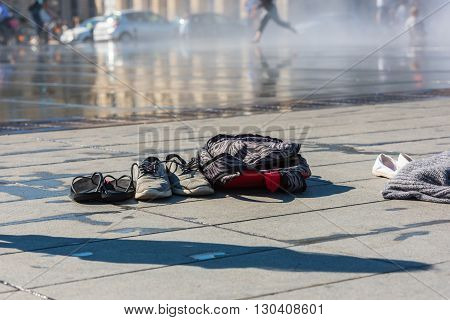 Family Shoes Left Near The Water