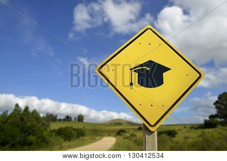 Education for all people access to schools in rural zone concept. Road sign with graduation cap icon on natural environment includes copy space.