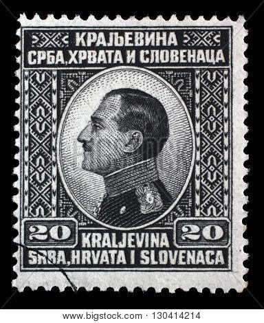ZAGREB, CROATIA - SEPTEMBER 13: A stamp printed in Yugoslavia (Kingdom Serbia, Croatia and Slovenia) shows King Alexander I of Yugoslavia, circa 1924, on September 13, 2014, Zagreb, Croatia