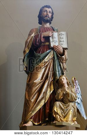 STITAR, CROATIA - AUGUST 27: Saint Matthew statue on the main altar in the church of Saint Matthew in Stitar, Croatia on August 27, 2015
