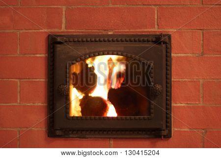 Cast iron furnace door in the brick oven photo