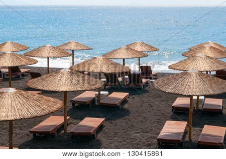 Black volcanic beach at Kamari Santorini Greece