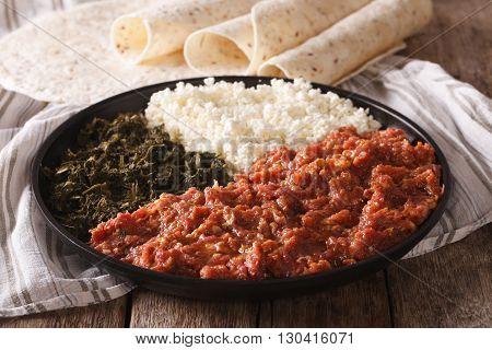 Ethiopian Food Kitfo: Marinated Beef With Herbs And Cheese Close-up And Injera. Horizontal