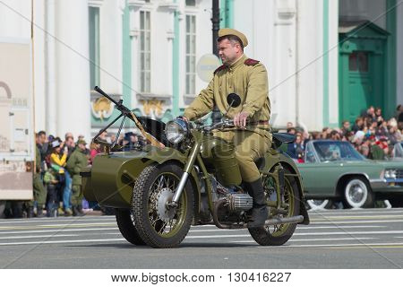 SAINT PETERSBURG, RUSSIA - MAY 05, 2015: Soldier in the form of the Great Patriotic War on the motorcycle M-72. Rehearsal for the Victory Parade