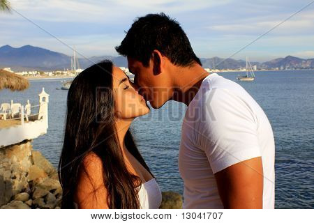 Couple Kissing By The Ocean